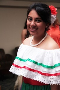 woman wearing traditional, embroidered Mexican dress