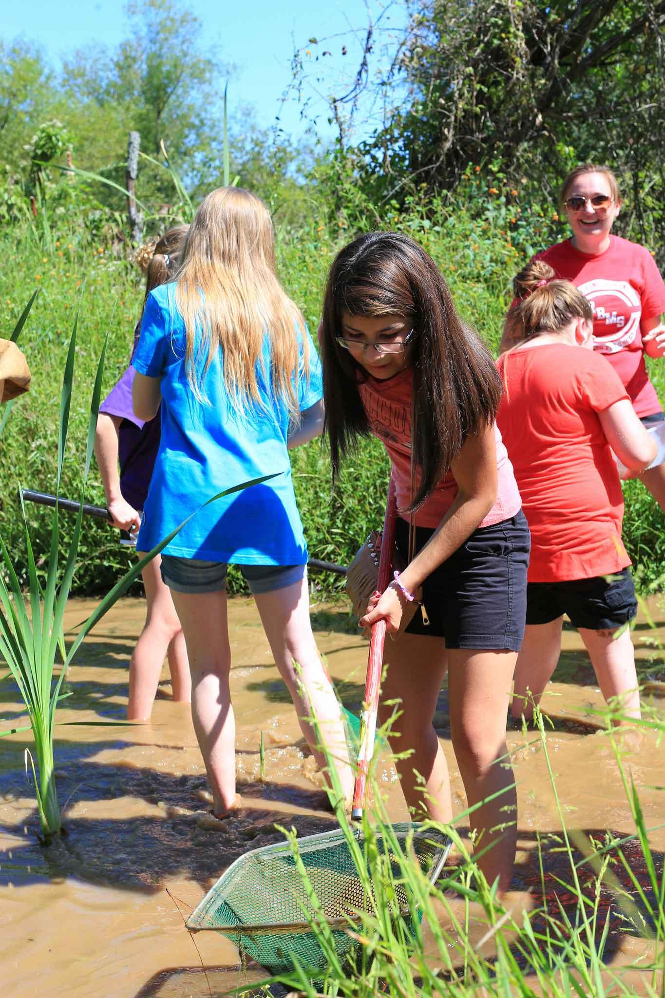 kids working in the wetlands