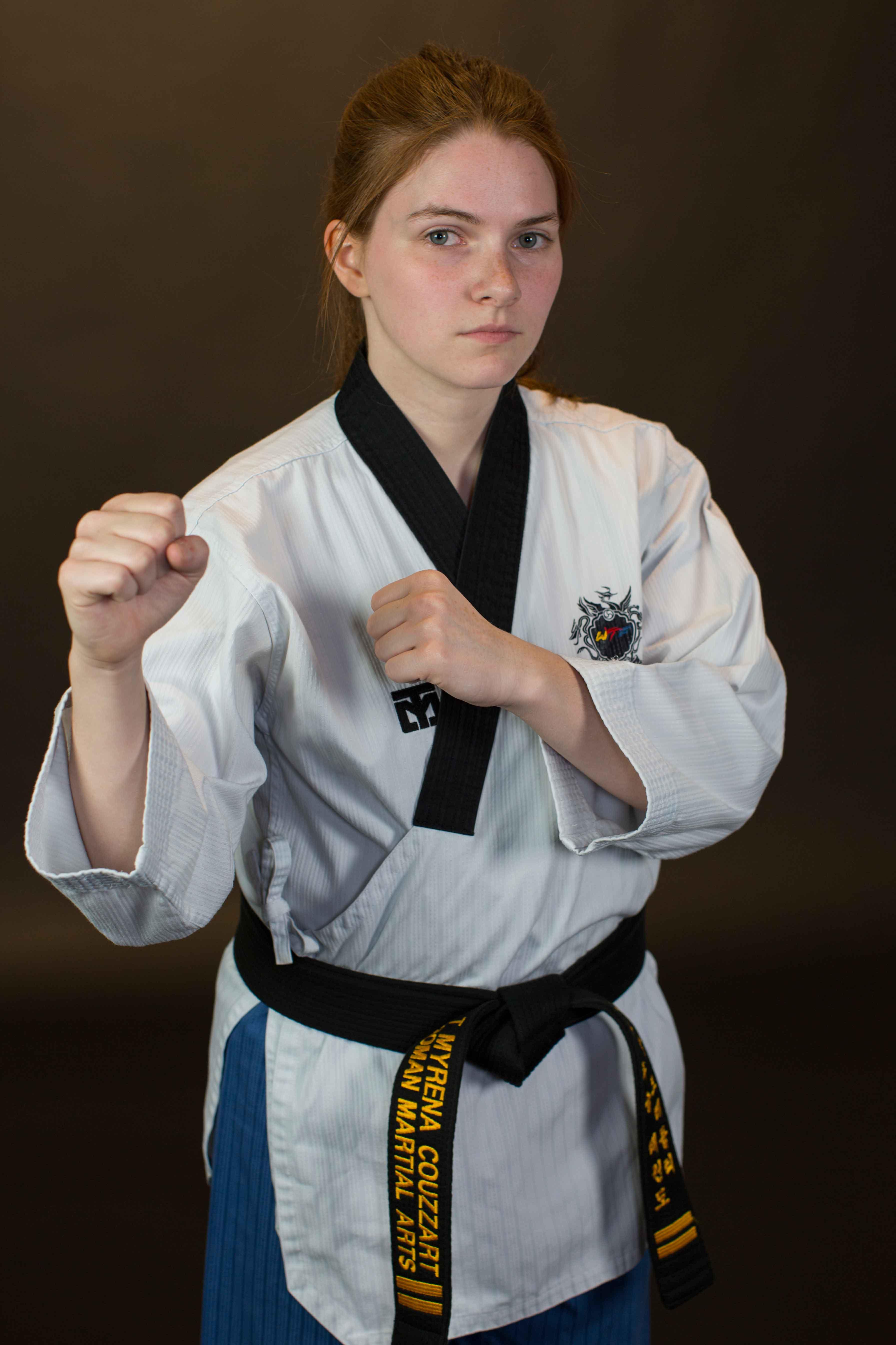student in martial arts uniform