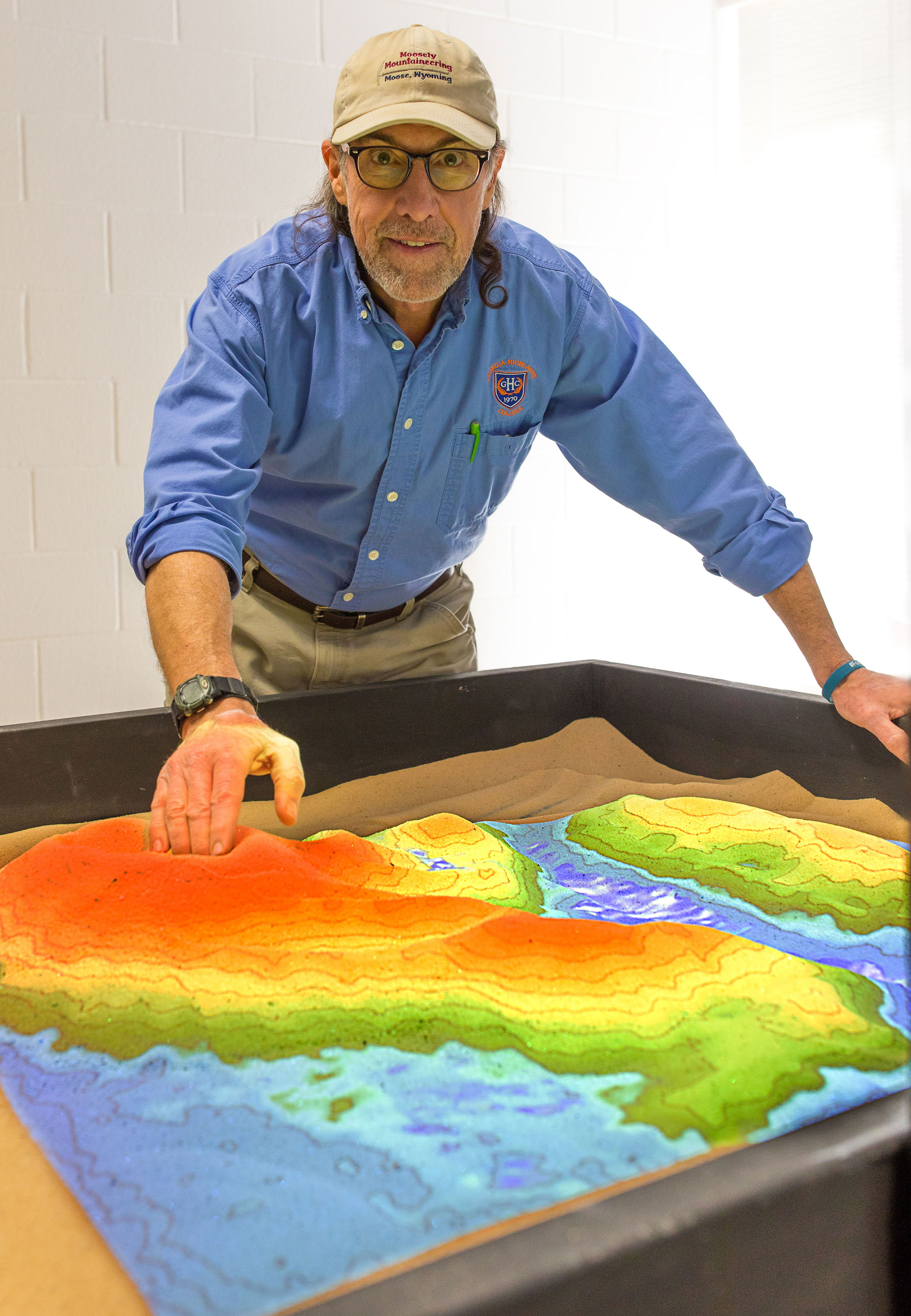 professor demonstrates sandbox