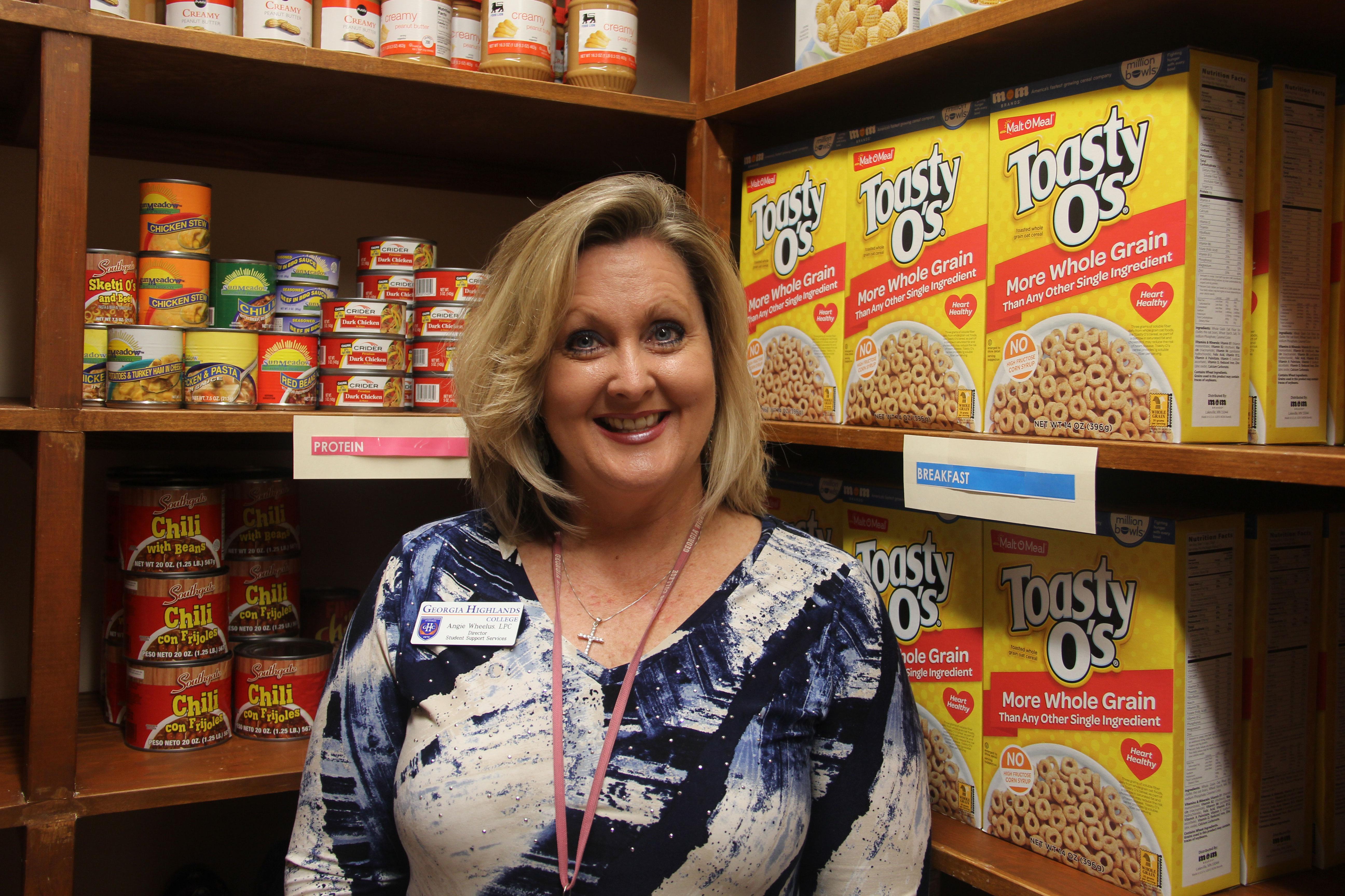 SSS member standing in food pantry