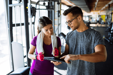 Image of two adults in a gym