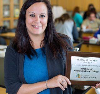 sarah holding award